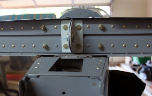 Another view of the four bolts holding the horizontal stabilizer to the F-711C vertical bars.