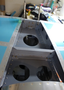 This is the best picture of the many bad pictures I took of the forward spar after drilling.  All four holes have good edge distance underneath.